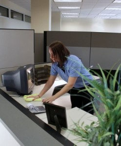 employee-cleaning-a-desk-for-final-touch-commercial-cleaning-331x400